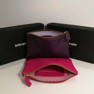 Merchandising premium clutch de piel Intrum